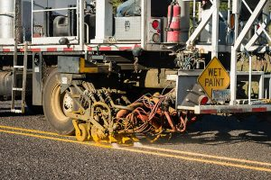 truck painting increased reflective striping on road